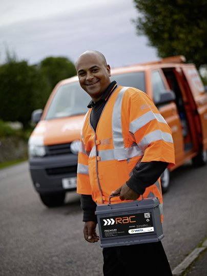 RAC employee holding a battery